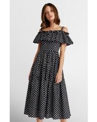 schwarzes gepunktetes schulterfreies Kleid von Apart