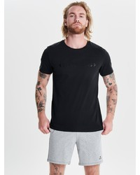 schwarzes T-Shirt mit einem Rundhalsausschnitt von FIRST