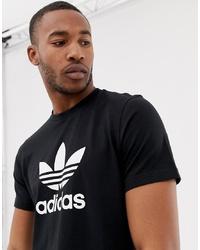 schwarzes und weißes bedrucktes T-Shirt mit einem Rundhalsausschnitt von adidas Originals