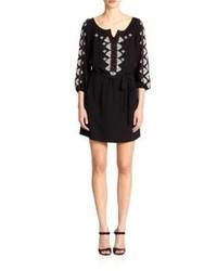 schwarzes und weißes besticktes Folklore Kleid