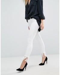 weiße enge Jeans mit Destroyed-Effekten von Blank NYC