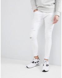 weiße enge Jeans mit Destroyed-Effekten von Liquor N Poker