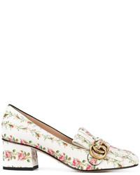 weiße Leder Slipper mit Blumenmuster von Gucci