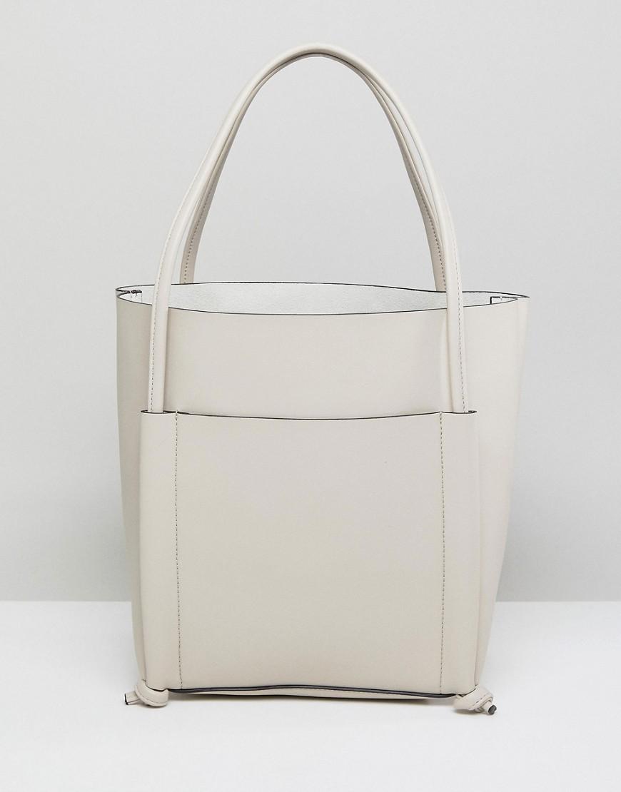 fb6c24e1efb9c ... weiße Shopper Tasche aus Leder von Qupid