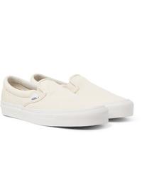 weiße Slip-On Sneakers aus Segeltuch von Vans