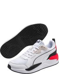 weiße Sportschuhe von Puma