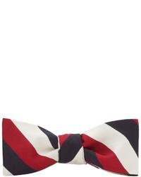 weiße und rote und dunkelblaue Fliege