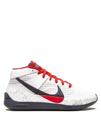 weiße und rote und dunkelblaue Sportschuhe von Nike