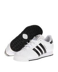 weiße und schwarze niedrige Sneakers