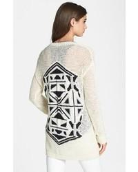 weiße und schwarze Strickjacke mit einer offenen Front mit geometrischen Mustern