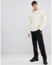 weißer Fleece-Pullover mit einem Kapuze