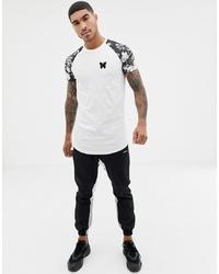 weißes und schwarzes T-Shirt mit einem Rundhalsausschnitt mit Blumenmuster von Good For Nothing
