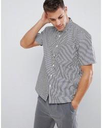 weißes und schwarzes vertikal gestreiftes Kurzarmhemd